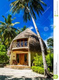 palm trees and beach bungalow bandos island maldives stock photo