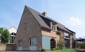 traditional style home westerland bricks enhance this traditional barn style home