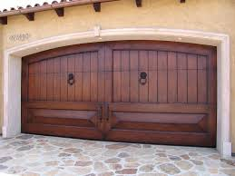 garage designing the elegance swing out garage door openers ideas exterior design home swing out garage door with bronze handle trims ideas feat stone pavers front door designs swing out garage