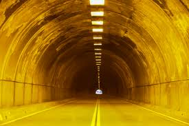free stock photo of tunnel with bright yellow lights