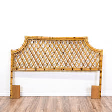 this tropical headboard is featured in a rattan with a glossy