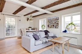 Living Room Grey Sofa by Cozy Living Room With Grey Sofa And Wooden Table With Grey Rug