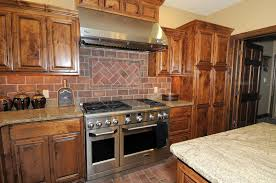 large rustic kitchen design with faux red brick backsplash and oak