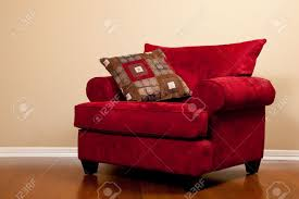 Oversized Chair by A Modern Red Fabric Oversized Chair On Hardwood Flooring In A