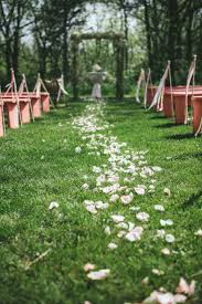 outdoor wedding ceremony aisle decorations floral aisle runner