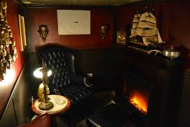 this guy built his own smoking lounge behind a secret bookcase