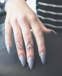 cute little california and disney castle finger tattoos from