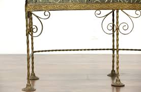 curved antique wrought iron bench with birds newly upholstered