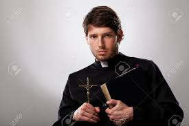 priest is holding a cross and holy bible stock photo