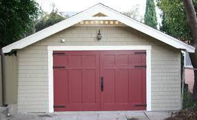 folding garage door more people switching from overhead garage doors to carriage doors