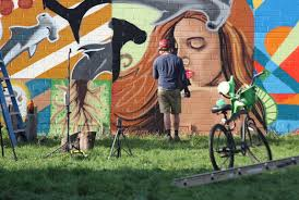 skye walker paints the carlsbad art wall walker s newest mural titled actuality reflects his san diego roots with oceanic and environmental themed iconography symbolizing one s place within their
