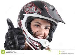 motocross helmet camera happy biker woman with a motocross helmet and thumb up royalty