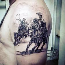 western style black and white cowboy with horses tattoo on upper