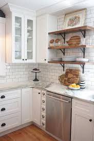 white shaker kitchen cabinets with white subway tile backsplash vintage kitchen remodel white shaker cabinets marble