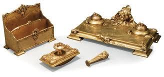 n馗essaire de bureau a marionnet nécessaire de bureau comprenant quatre éléments en bronze