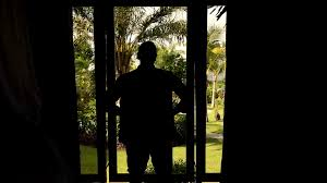 silhouette of man opening curtain slow motion closeup stock video