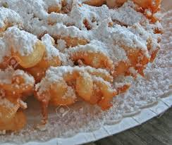 fresh funnel cake with powdered sugar topping stock photo picture