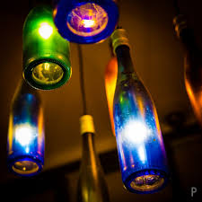upcycle empty bottles into led lamps earth911 com