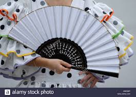held fan woman holding held fan spain stock photo 11281149