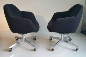 pair of mid century modern tilt swivel desk chairs by steelcase at
