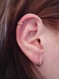 ear piercing hoop lobe and ear ring hoop piercing on girl ear golfian