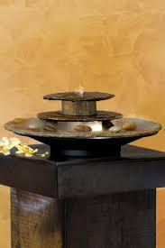fontaine en pierre naturelle fontaine en pierre sombre forme circulaire basse seliger