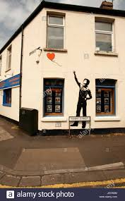 banksy style mural graffiti red phone box in great malvern stock banksy style wall mural in fanny street cardiff with a heart shaped balloon