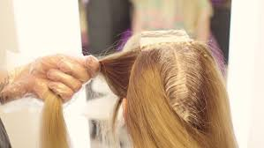 hairdresser dye the hair he separates the strands of hair comb