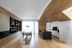 kitchen island montreal wooden surfaces connect living spaces in this montreal home built in