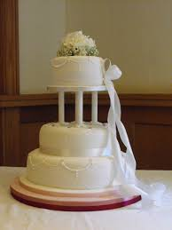 cake pillars stacked wedding cake with pillars and piping detail no flower on