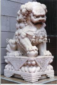 lions statues carved lion sculpture style gate guardian