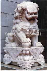 lions statues carved lion sculpture style gate guardian