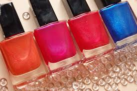 review avon magic effects neon nail polishes striking pink red