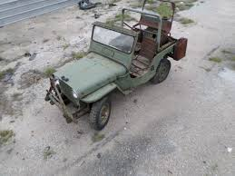 seller of classic cars 1951 willys jeep green green