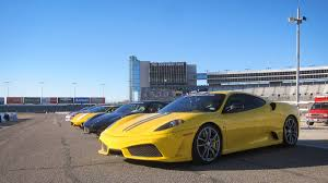 exotic cars lined up drive supercars with christian fittipaldi