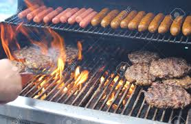 Backyard Grill Com by Flames Flare Up As Dogs And Hamburgers Being Tended By The