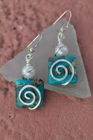 4 Ideas For Jewelry Making - blue kyanite silver swirl wire wrapped earrings by blackwoodarts