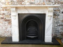 antique caurved black fireplace box surrounding at white marble