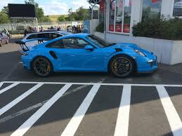 blue porsche 911 a very beautiful blue porsche 911 gt3 rs in the nordschleife