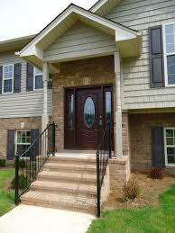 front entry portico on raised ranch not this style but this is