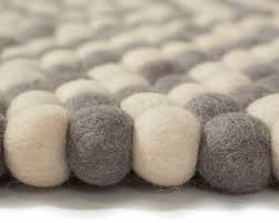 grey carpet with white balls handmade by in nepal