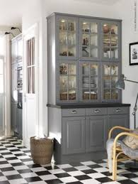stainless steel mesh cabinet faces show off dishware kitchens