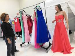 fairy godmothers u0027 help students choose the perfect prom gowns