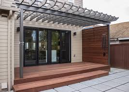 Concrete Pergola Designs by Mahogany Deck And Screen Concrete Pavers And A Sleek Pergola