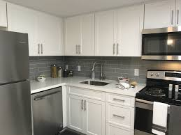 white kitchen cabinets with stainless steel backsplash uptown22 kitchens with tile backsplash uptown 22 apartments