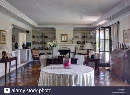 white cloth on circular table in traditional spanish living room