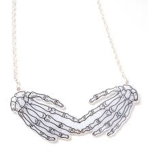 skeleton hands necklace touched by a skeleton