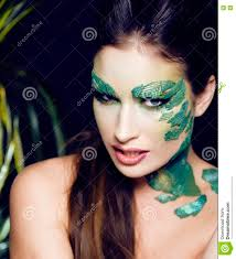 woman with creative make up like snake and rat in her hands