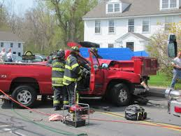 four injured one critically after dump truck vs pickup truck on