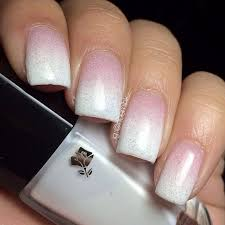 this gradient of soft pink and white nail polish layered with